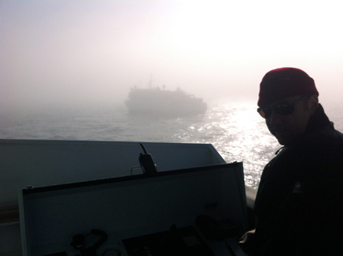 Captain Bernd Buchner of the R/V Falkor outside the bridge with the Western Flyer in the background.