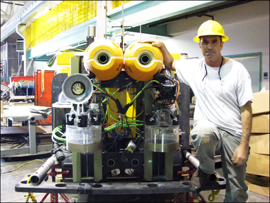 Mechanical Technician John Ferreira helped build the Benthic Rover, seen here in the MBARI Machine Shop.