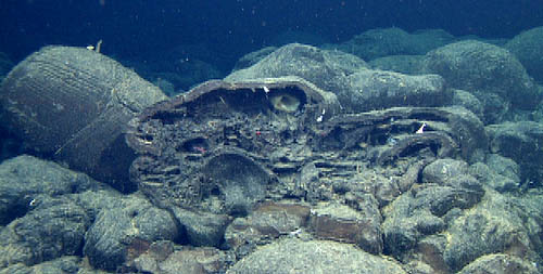 Favorite picture of the day: a lobate lava at the rim of Cage Seamount has been broken open to reveal drainage shelves (horizontal layering) formed while lava was coursing through the pillow, and the mold of an adjacent pillow that formed against it and has since fallen away (just left of center).