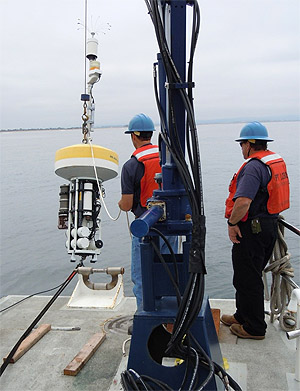 MBARI staff deploy a mooring carrying a DuraFET pH sensor in Monterey Bay. Image: Ken Johnson © 2013 MBARI.