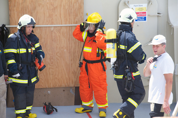 Safety drills are an important part of preparing for sea voyages. Here the ship's crew practices fighting a fire with specialized equipment. The science team also practices the process of responding to general alarm and evacuation bells. Life vest, long sleeve shirt, long pants, and a hat are required for all personnel in the event of an emergency.