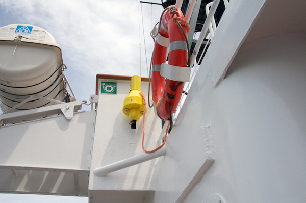 As part of the safety orientation, the captain shows the science team the location of safety gear around the ship. Here is a life ring that would be thrown into the ocean if a person were to fall overboard. These buoys provide flotation and also help visually mark the location so that the person can be rescued.