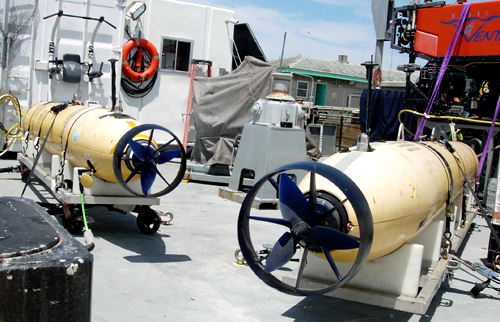 The Gulper AUV (left) and the mapping AUV (right) are secured aboard the Rachel Carson. This is the first time the Carson has had both AUVs and the ROV Ventana on the back deck.
