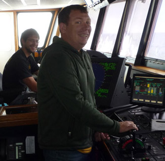 There are always two people on watch on the bridge. Captain Andrew McKee (at the controls in the forefront) and engineer Fred Peemoeller (in back).