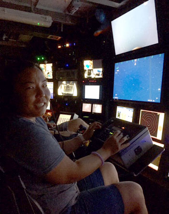 Anela sits at the science camera controls in the Western Flyer control room.