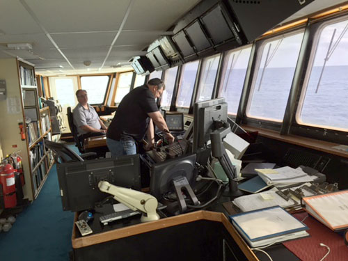 Relief Captain George Gunther and Electronics Officer Dan Chamberlain on the bridge.