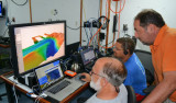 David Caress, Hans Thomas, and Alejandro Hinojosa of CICESE explore the bathymetry of a submarine canyon collected before the AUV was snagged.