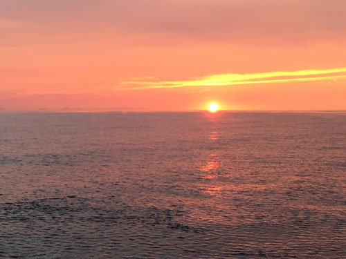 Sunset, just before the green flash! The tip of the Baja Peninsula is on the horizon to the left.