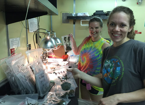 Chrissy Maschmeyer and Abbie Johnson holding baggies with two-centimeter slices of sediment extruded from push cores taken yesterday. We will sieve the bottommost interval of each core and pick out the tiny foraminifera shells for radiocarbon dating.
