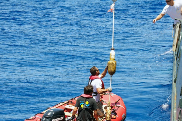 Lone Ranger crew retrieve a derelict buoy found drifting past the ship.