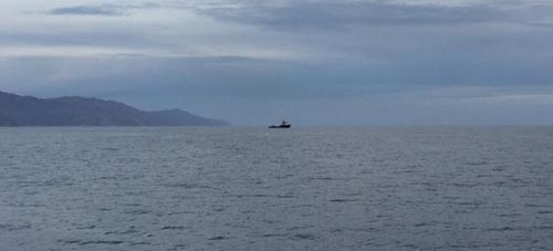 The R/V Rachel Carson waits in the distance while ROV Doc Ricketts worked to free the AUV.