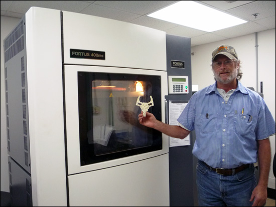 Ray Thompson, the machine shop supervisor at MBARI, in front of a 3D printer.