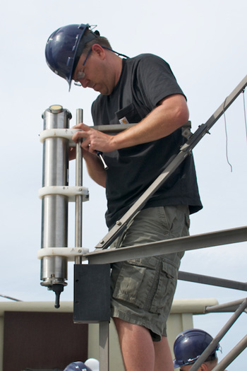 Michael Risi mounts an acoustic Doppler current meter to the frame of the Sargasso deep-sea observatory. The instrument will record current speed and direction data during the six-month deployment. Photo: Debbie Nail Meyer