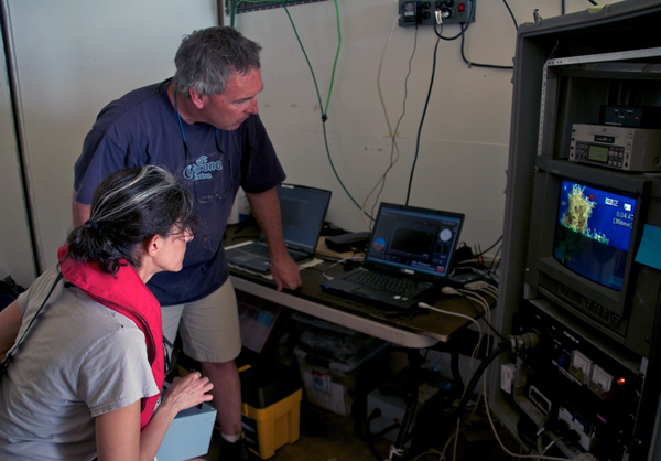 Alana Sherman and Dale Graves operate the ROV Phantom. The video shows a piece of Sargassum seaweed that was attached to the robot for observation.