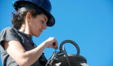 "Alana Sherman ""seizes"" (binds with thread) the final shackle on the camera tripod."