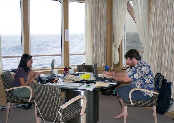 Alana Sherman and Jake Ellena work on their computers. We are waiting for weather conditions to improve and for official approval to conduct sampling at our final station that is located about 85 kilometers southeast of Bermuda. This location lies within Bermuda's Exclusive Economic Zone, a territorial region that extends 370 kilometers (200 nautical miles) from the coastline.