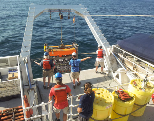 The crew launched the Benthic Respiration System over the stern of the Western Flyer.