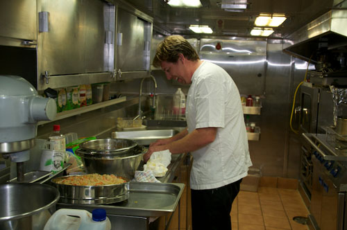 Head Chef Andrew Croft-Brown prepares spring rolls in the ship's galley.