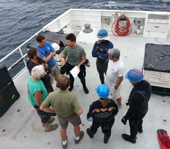The blue water divers assemble for a safety meeting at the beginning of the cruise to go over the proper standard operating procedures for the dive. Safety is critically important when you are nearly 120 kilometers from land.