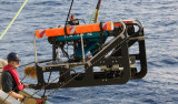 Ken Smith handles the tether line to ROV Phantom during launch into the Sargasso Sea.