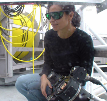 Kakani Katija calibrates the vortex generator which creates a consistent flow to compare her in situ methods with her laboratory results. She wears dark safety glasses to protect her eyes when working with lasers.