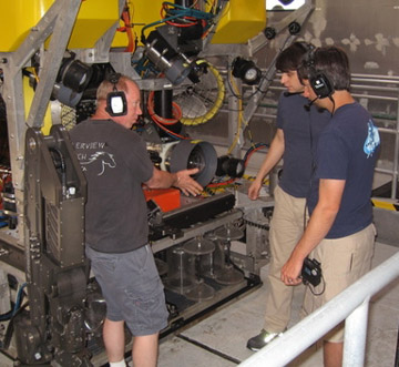 ROV pilots Knute Brekke, Bryan Schaefer, and Ben Erwin do a last minute check of the systems on the ROV.