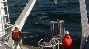 Erich Rienecker and Chris Wahl lower the CTD rosette into Monterey Bay for our first cast of the cruise.