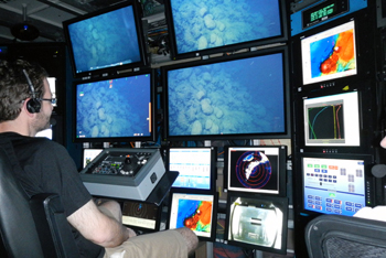 Brian Dreyer at the camera controls in the ROV control room.