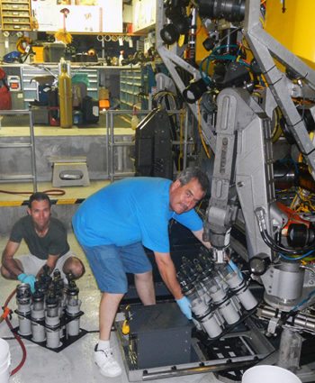 Ronald Spelz and Rigoberto Guardado reload the push core racks on the ROV in preparation for the next dive.