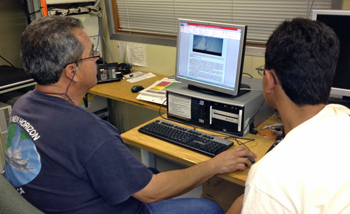 Rigoberto Guardado and Hiram Rivera translating our daily log. Read today's log in Spanish.