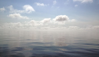 The clouds appeared to melt into the windless, glassy sea this morning.