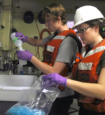 Abbey Chrystal, right, helps Joe Murray process water samples for his study of agricultural run-off into the Gulf of California waters.