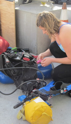 Meghan Powers double-checks her dive gear. Photo by Kyra Schlining