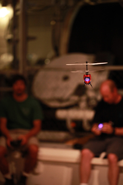 In their off time, the ROV pilots hone their flying skills with remote controlled helicopters in the moon pool.