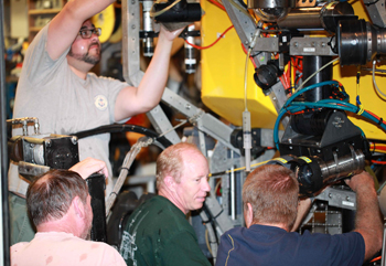 ROV pilots Eric Martin (top left), Bob Waters (lower left), Knute Brekke (center), and Randy Prickett make some adjustments to Doc Ricketts.