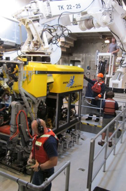 ROV pilots, Knute Brekke and Randy Prickett, work with the ship's crew Andrew McKee and Olin Jordan to relaunch the ROV. All the pilots and crew are needed to assist during the daily launches and recoveries.
