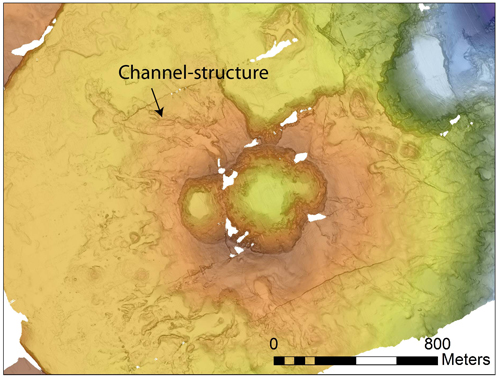 Figure 2: Pair of small craters with channel structures radiating outward. The dive began on the floor of the smaller of the two craters that you can see here, and the channel-structure we flew along is indicated by the arrow.