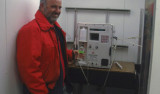 Tim Pennington at the instrument for running salinity tests, which are usually performed by Curt Collins.