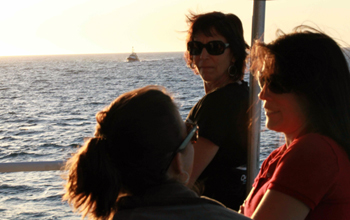 Eve Lundsten, Teresa Cardoza, and Krystle Anderson. On the horizon, the R/V Zephyr approaches for today's