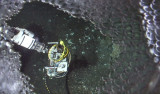 A bird's eye view of the gas sampler (held by manipulator arm) as it catches bubbles to measure gas composition at this site. The high-definition camera caught gas-hydrate coated bubbles on its housing.