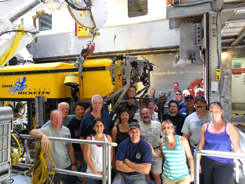 The science team, ROV pilots, and many members of the ship's crew gathered around the ROV for a final group photo as the ship was steaming to port.