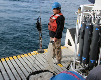 Haibin Zhang stands on the well deck in anticipation of his plankton tow. Photo: Monique Messié