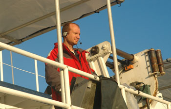 Deckhand Jason Jordan running the winch during this morning's CTD cast.