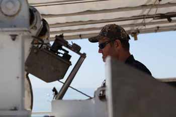 Olin Jordan is operating the A-frame to deploy the gravity corer.