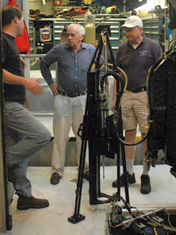 At the end of the day, Chief Scientist Peter Brewer, center, meets with his team, Peter Walz, left, and Ed Peltzer, to discuss how to improve the performance of their newest tool, the tripod, designed to precisely guide the laser probe into the seafloor.