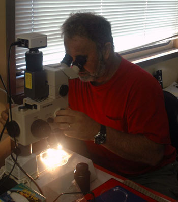 Tim Pennington has a look at the zooplankton Haibin Zhang pulled in on his last plankton tow.