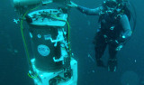 diver with environmental sample processor