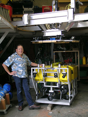 Engineer Farley Shane with model of ROV Doc Ricketts