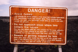 Sign near active flows on Kilauea Volcano warning of potential hazards. Photo © 2001 J.B. Paduan