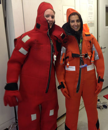Jessica Whelpley (left) and Cheryl Gansecki don immersion suits during our safety briefing.